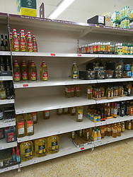 © Licensed to London News Pictures. 06/03/2020. Cobham, UK. As the threat of the coronavirus bug continues cooking oil shelves are depleted in Sainsbury's in Cobham, Surrey. Photo credit: LNP