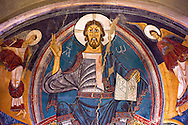 Romanesque frescoes from the Church of Sant Clement de Taull, Vall de Boi, Alta Ribagorca, Spain. Painted around 1123 depicting Christ Pantocrator or In Majesty.  National Art Museum of Catalonia, Barcelona. MNAC 15806 .<br /> <br /> Visit our SPAIN HISTORIC PLACES PHOTO COLLECTIONS for more photos to download or buy as wall art prints https://funkystock.photoshelter.com/gallery-collection/Pictures-Images-of-Spain-Spanish-Historical-Archaeology-Sites-Museum-Antiquities/C0000EUVhLC3Nbgw <br /> .<br /> Visit our MEDIEVAL PHOTO COLLECTIONS for more   photos  to download or buy as prints https://funkystock.photoshelter.com/gallery-collection/Medieval-Middle-Ages-Historic-Places-Arcaeological-Sites-Pictures-Images-of/C0000B5ZA54_WD0s