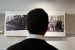 March 30, 2019 - Madrid, Spain - Iigo Errejon (R) seen looking at the photographs of the exhibition. The candidate of ''Mas Madrid'' to the Community, Iigo Errejon, visits the exhibition ''Madrid, how good you are!'' from photographer Javier Marquerie. (Credit Image: © Jesus Hellin/NurPhoto via ZUMA Press)
