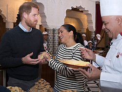 Prince Harry, Duke of Sussex, and Meghan Markle, Duchess of Sussex visit a cooking demonstration where under privileged children are learning to cook under Chef Moha Fedal at the Villa des Ambassadors in Rabat, Morocco, on the 25th February 2019. 25 Feb 2019 Pictured: Prince Harry, Duke of Sussex, Meghan Markle, Duchess of Sussex. Photo credit: MEGA TheMegaAgency.com +1 888 505 6342