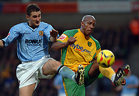Photo: Ashley Pickering.<br />Norwich City v Hull FC. Coca Cola Championship. 25/11/2006.<br />Hull's Nicky Forster (L) and Norwich's Dion Dublin (R)