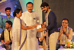 July 24, 2017 - Kolkata, West Bengal, India - Chief Minister Mamata Banerjee (left) felicitate Bengali film Actor Prosenjit Chatterjee (right) with Mahanayak Uttamkumar Puroskar or award during death anniversary of Legend Actor Uttam Kumar. West Bengal Chief Minister Mamata Banerjee along with actor Prosenjit Chatterjee and others on the occasion of felicitation of Mahanayak Uttamkumar Puroskar or award during death anniversary of Legendary Actor Uttam Kumar in Kolkata on July 24, 2017. (Credit Image: © Saikat Paul/Pacific Press via ZUMA Wire)