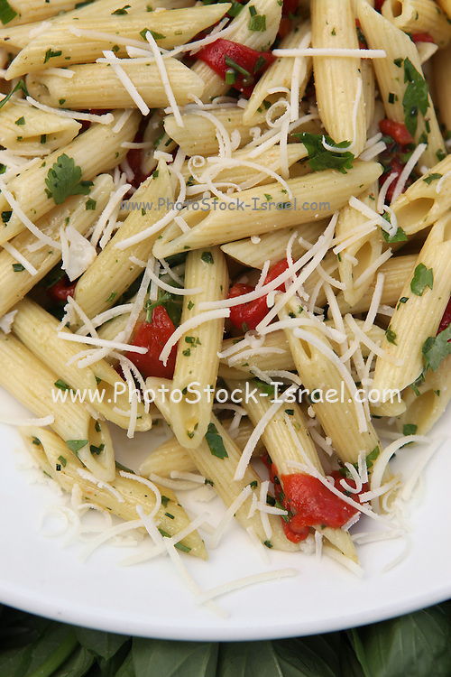 A serving of Penne pasta with olive oil and herbs
