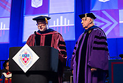 David Miller, interim provost, presents the Via Sapientiae Award to Robert O'Keefe, Department of Marketing, as DePaul University's Driehaus College of Business participated in the 117th commencement ceremonies on Sunday, June 14, 2015, at Allstate Arena in Rosemont, IL.(DePaul University/Jamie Moncrief)