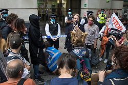 London, UK. 4th September, 2020. Extinction Rebellion spokesperson Rupert Read addresses activists from HS2 Rebellion, an umbrella campaign group comprising longstanding campaigners against the HS2 high-speed rail link as well as Extinction Rebellion activists, at a protest outside the Department for Transport. Activists glued themselves to the doors and pavement outside the building and sprayed fake blood around the entrance during a protest which coincided with an announcement by HS2 Ltd that construction of the controversial £106bn high-speed rail link will now commence.