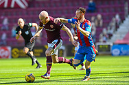 David Carson (#8) of Inverness Caledonian Thistle FC tries to pull back Liam Boyce (#10) of Heart of Midlothian FC during the SPFL Championship match between Heart of Midlothian and Inverness CT at Tynecastle Park, Edinburgh Scotland on 24 April 2021.