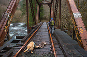 Odd find of old hip boots on abandon railroad bridge trussle that has Kada uneasy.