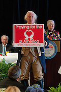 Mark Matson for American-Statesman (5/4/10)  The Texas State Prayer Breakfast, part of the National Day of Prayer activites,  was held Tuesday morning at the Doubletree Hotel in Austin. Mark Collins of San Antonio, dressed as George Washington, holds a sign supporting prayer for the country.