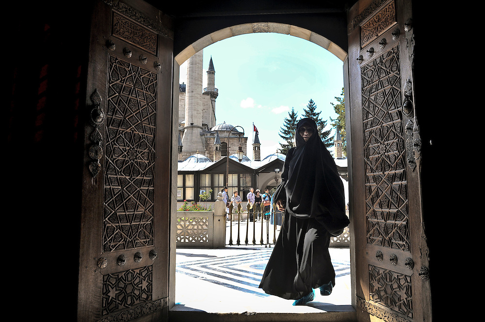Konya, Turkey 22 September 2008<br /> Main entrance to the Mevlana Mausoleum.<br /> Sufism is a mystical tradition of Islam. <br /> It is also considered as a spiritual and ascetic movement of Islam with esoteric doctrines appeared during the VIII century. <br /> The Muslim Sufis are people who privilege internalization, the love of god, contemplation and wisdom. <br /> A practitioner of this tradition is generally known as a Sufi, another name used for the Sufi seeker is Dervish. The Sufi movement has spanned several continents and cultures over a millennium, at first expressed through Arabic, then through Persian, Turkish, and a dozen other languages. <br /> Sufi orders, most of which are Sunni in doctrine, trace their origins from the Prophet of Islam, Muhammad, through his cousin Ali or his father-in-law Abu Bakr.<br /> According to some modern proponents, the Sufi philosophy is universal in nature and its roots predate the arising of the modern-day religions. <br /> The whirling dance or Sufi whirling that is associated with dervishes, is the practice of the Mevlevi Order in Turkey, and is just one of the physical methods used to try and reach religious ecstasy.<br /> Condemned by traditional Islam, the Sufism cultivates the mystery; the idea being that Muhammad would have received at the same time the Koran and esoteric revelations.<br /> Photo: Ezequiel Scagnetti