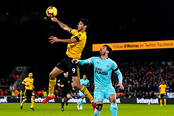 Raul Jimenez of Wolverhampton Wanderers controls the ball above Fabian Schar of Newcastle United - Mandatory by-line: Robbie Stephenson/JMP - 11/02/2019 - FOOTBALL - Molineux - Wolverhampton, England - Wolverhampton Wanderers v Newcastle United - Premier League