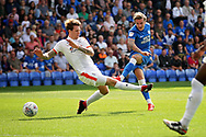Peterborough United forward Jason Cummings (35) scores his second goal 3-0 Posh during the EFL Sky Bet League 1 match between Peterborough United and Luton Town at London Road, Peterborough, England on 18 August 2018.