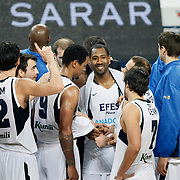 Efes Pilsen's Bootsy THORNTON (C) and Nikola VUJCIC (R) during their Turkish Basketball league match Efes Pilsen between Tofas at the Sinan Erdem Arena in Istanbul Turkey on Sunday 27 February 2011. Photo by TURKPIX