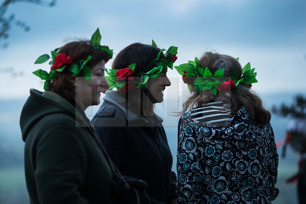 © Licensed to London News Pictures. 01/05/2017. Albury, UK. Visitors to St Martha's Hill watch as The Pilgrim Morris Men of Guildford dance at first light on May Day. Photo credit: Peter Macdiarmid/LNP