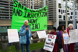 London, UK. 17 October, 2019. Ellen Lebethe of Lambeth Pensioners Action Group (LAMPAG) addresses campaigners from Fuel Poverty Action (FPA), residents in uninsulated homes and climate activists protesting outside the Ministry of Housing, Communities and Local Government (MHCLG) before delivering a letter signed by FPA, 80 organisations, trade unions and MPs in just ten days precisely one year after a strongly worded letter about the urgency of recladding flammable buildings and insulating those that are cold was delivered to the Government department. Commitments made by the MHCLG in response to the original letter have not been met. Credit: Mark Kerrison/Alamy Live News