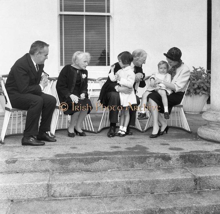 At Aras an Uachtarain, Sinead, Bean de Valera and President Eamon de Valera help Prince Rainier and Princess Grace with looking after Prince Albert and Princess Caroline. .14.06.1961