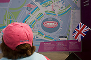 Spectators consult a detailed map of the Olympic Park during the London 2012 Olympics. This land was transformed to become a 2.5 Sq Km sporting complex, once industrial businesses and now the venue of eight venues including the main arena, Aquatics Centre and Velodrome plus the athletes' Olympic Village. After the Olympics, the park is to be known as Queen Elizabeth Olympic Park.