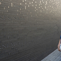 Woman visits the newly inaugurated Memorial of Unity that is decorated with names of Hungarian towns (many of them belonging to neighbouring countries since the Treaty of Trianon) engraved onto the walls on the national holiday celebrating the foundation of the Hungarian State in Budapest, Hungary  on Aug. 20, 2020. ATTILA VOLGYI