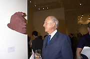 Lord Glenconner looking at work by David Mach. . Crusaid preview. Vinopolis. 11 October 2000. © Copyright Photograph by Dafydd Jones 66 Stockwell Park Rd. London SW9 0DA Tel 020 7733 0108 www.dafjones.com