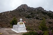 A grave beside a chapel in the Crete mountains close to the small city of Palaiochora which is a small town in the Chania regional unit on the island of Crete, Greece. It is located 77 km south of Chania, on the southwest coast of Crete and occupies a small peninsula 400m wide and 700m long. The town is set along 11 km of coastline bordering the Libyan Sea. Its population was 1,675 in the 2011 census. Palaiochora's economy is based on tourism and agriculture (mainly tomatoes cultivated in glass houses and also olive oil).