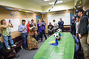 Family, teaching staff, and coaches take photos of Sarina Bolden and Jason Scrempos during the NCAA National Signing Day event at Milpitas High School in Milpitas, California, on February 4, 2015. (Stan Olszewski/SOSKIphoto)
