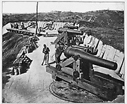 Battery Sherman, on the Jackson Road, before Vicksburg, Mississippi. [The siege of Vicksburg (May 18 – July 4, 1863) was the final major military action in the Vicksburg campaign of the American Civil War. In a series of maneuvers, Union Maj. Gen. Ulysses S. Grant and his Army of the Tennessee crossed the Mississippi River and drove the Confederate Army of Mississippi, led by Lt. Gen. John C. Pemberton, into the defensive lines surrounding the fortress city of Vicksburg, Mississippi]. from the book ' The Civil war through the camera ' hundreds of vivid photographs actually taken in Civil war times, sixteen reproductions in color of famous war paintings. The new text history by Henry W. Elson. A. complete illustrated history of the Civil war