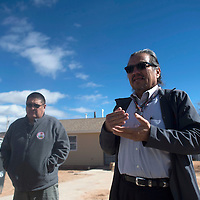 Earl Tulley, Senior Development Coordinator for Navajo Housing Authority, explains housing projects during a tour in Window Rock Thursday, February 23.