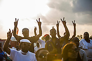 The crowd watch Sabrina Fulton and Tracy Martin, Trayvon Martins parents, speak at Peace Fest in Forest Park, St. Louis, Mo. on Sunday, August 24th, 2014. (Photo by Samuel Corum)