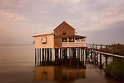 A house on stilts sits right on the water in Nags Head, North Carolina