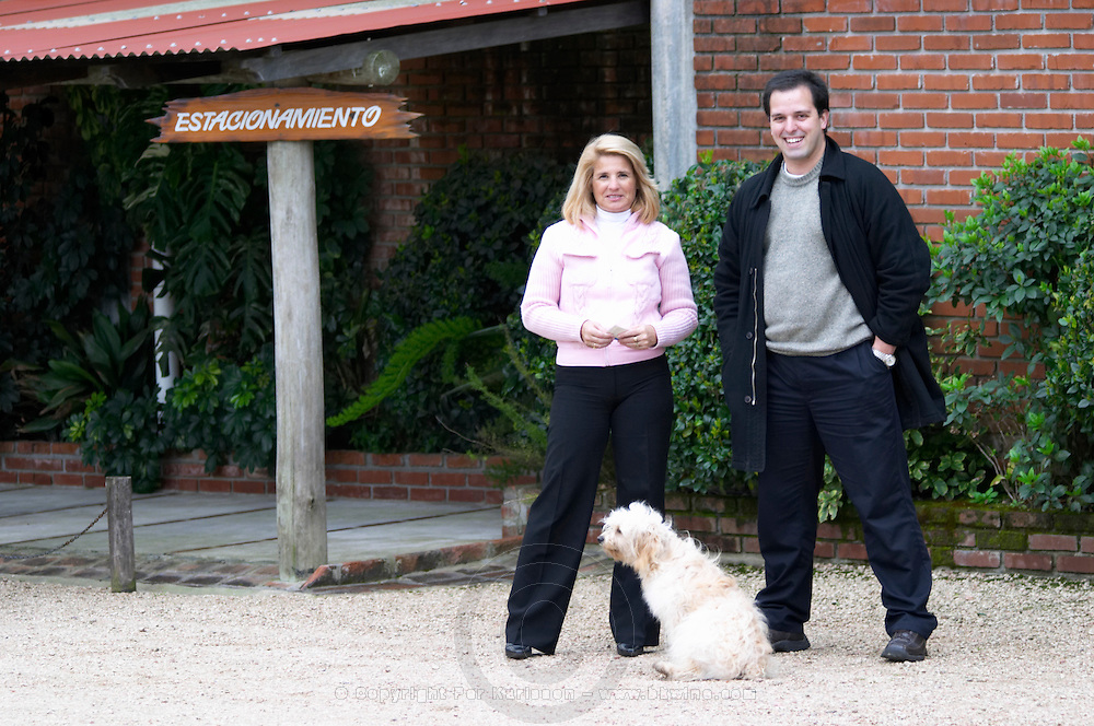 Virginia Moreira de Stagnari the owner and the wine maker and the dog in front of the winery. Bodega Vinos Finos H Stagnari Winery, La Puebla, La Paz, Canelones, Montevideo, Uruguay, South America