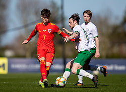 WREXHAM, WALES - Friday, March 26, 2021: Wales' Niall Huggins (L) and Republic of Ireland's Will Ferry during an Under-21 international friendly match between Wales and Republic of Ireland at Colliers Park. Republic of Ireland won 2-1. (Pic by David Rawcliffe/Propaganda)