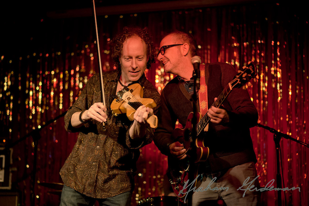 Guitarist Jack Silverman and electric violinist Tracy Silverman (no relation) trade licks during their shared performance at the Stone Fox in Nashville, TN. The show was sponsored by the Nashville Fringe Festival.