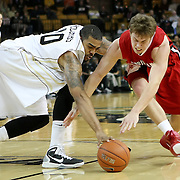 Central Florida forward Dwight McCombs (10) fights for the ball against Louisiana's guard David Perez (15) during their game at the UCF Arena on December 15, 2010 in Orlando, Florida. UCF won the game79-58. (AP Photo/Alex Menendez)