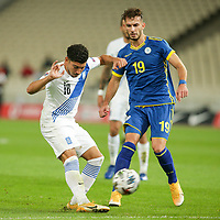 ATHENS, GREECE - OCTOBER 14: Dimitris Limniosof Greece and Leart Paqaradaof Kosovo during the UEFA Nations League group stage match between Greece and Kosovo at OACA Spyros Louis on October 14, 2020 in Athens, Greece. (Photo by MB Media)