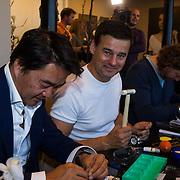 NLD/Amsterdam/20131003 -  Dad's moment , Wilfred Genee zet horloge in elkaar