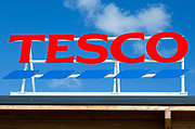 Sign for Tesco supermarket store against blue sky, Calne, Wiltshire, England, UK