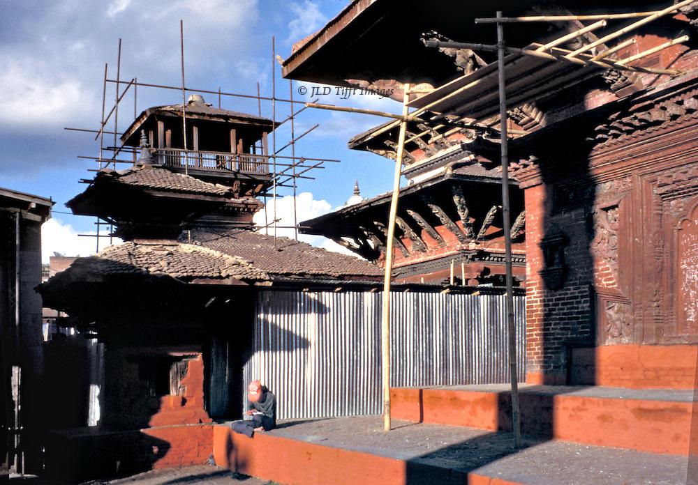 Kathmandu, Durbar Square, temples under restoration; supports; corrugated tin walls..