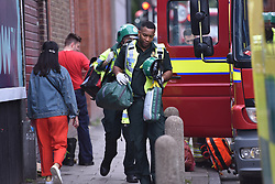 © Licensed to London News Pictures. 15/08/2019. London, UK. Ambulance crew at Clapham North Station, where emergency services respond to an incident involving a man who reportedly took his life in front of his family, jumping onto the tracks as a train pulled into the platform. Attending HEMS Air Ambulance, fire crews and paramedics were unable to save the man. Photo credit: Guilhem Baker/LNP