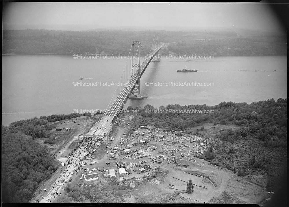 0103-A046 Grand opening of the Tacoma Narrows Bridge, October 14, 1950 showing toll booth plaza on east approach.