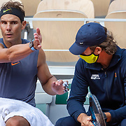 PARIS, FRANCE September 26. Rafael Nadal of Spain in discussion with coach Carlos Moya during a practice match with Jannik Sinner of Italy on Court Philippe-Chatrier in preparation for the 2020 French Open Tennis Tournament at Roland Garros on September 26th 2020 in Paris, France. (Photo by Tim Clayton/Corbis via Getty Images)