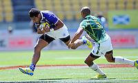 Samoa's Alatasi Tupou runs around South Africa's Cornal Hendricks at the IRB International Rugby Sevens, Westpac, Wellington, New Zealand, Friday, February 01, 2013. Credit:SNPA / Ross Setford