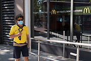 Face mask outside McDonalds on 25th June 2020 in London, England, United Kingdom. As the July deadline approaces and government will relax its lockdown rules further, the West End remains quiet, while some non-essential shops are allowed to open with individual shops setting up social distancing systems.