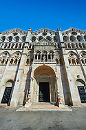 Facade of the 12th century Romanesque Ferrara Duomo, Italy . Ferrara Cathedral (Basilica Cattedrale di San Giorgio, Duomo di Ferrara) is a Roman Catholic cathedral and minor basilica in Ferrara, Northern Italy. The original Romanesque design of Ferrara Cathedral is manifest in the façade. In the centre of the façade of Ferrara Cathedral is a porch, supported by two columns with Atlases seated on lions at the bases. It is decorated with a Last Judgement by an unknown master and a loggia with a Madonna and Child (a late Gothic addition). The portal of Ferrara Cathedral is the work of the sculptor Nicholaus, a pupil of Wiligelmus. The lunette shows Saint George, patron saint of Ferrara, slaying the dragon; scenes from the Life of Christ appear on the lintel. The jambs framing the entrance of Ferrara Cathedral are embellished with figures depicting the Annunciation and the four prophets who foretold the coming of Christ.<br /> <br /> Visit our ITALY PHOTO COLLECTION for more   photos of Italy to download or buy as prints https://funkystock.photoshelter.com/gallery-collection/2b-Pictures-Images-of-Italy-Photos-of-Italian-Historic-Landmark-Sites/C0000qxA2zGFjd_k<br /> <br /> If you prefer to buy from our ALAMY PHOTO LIBRARY  Collection visit : https://www.alamy.com/portfolio/paul-williams-funkystock/ferrara.html .