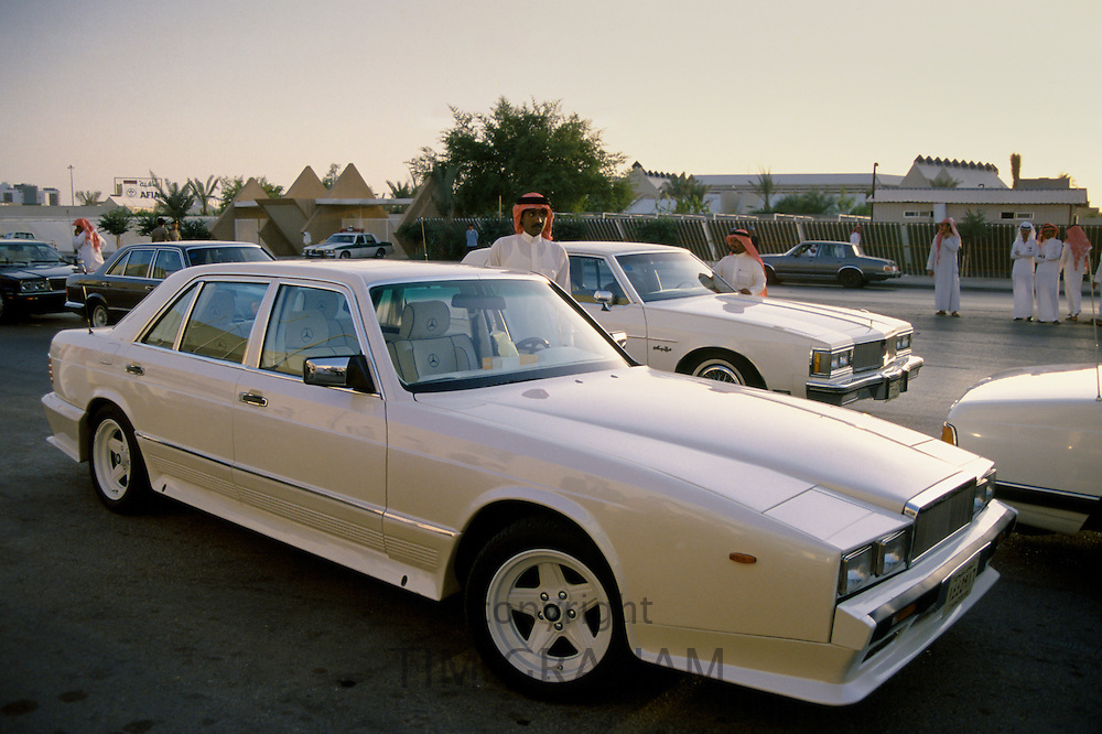 Chauffeurs with limousines while owners are watching horseracing in Riyadh, Saudi Arabia