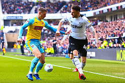 Ben Wiles of Rotherham United attempts to hold off Scott Malone of Derby County - Mandatory by-line: Ryan Crockett/JMP - 30/03/2019 - FOOTBALL - Pride Park Stadium - Derby, England - Derby County v Rotherham United - Sky Bet Championship