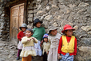 """Children stand by a wall in Llamac (10,000 feet elevation), Cordillera Huayhuash, Andes Mountains, Peru, South America. Campesinos are the rural, country folk of Peru. Published in """"Climbs and Treks in the Cordillera Huayhuash of Peru"""" guidebook by Jeremy Frimer 2005, ISBN #0-9733035-5-7, Elaho Publishing (www.elaho.ca)."""
