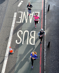 Hundreds of runners took to the cycle paths and bus lanes of Edinburgh today for the annual Edinburgh Kilomathon, which started at Ocean Terminal in Leith and ended at Murrayfield Stadium, The runners hope to raise tens of thousands of pounds for a string of charities.<br /> <br /> © Dave Johnston / EEm