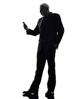 One Caucasian Senior Business Man on the telephone angry Silhouette White Background