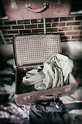 Suitcase containing clothes belonging to ex-patients of West Park Asylum, Epsom, Surrey, processed to emulate wet plate technique.