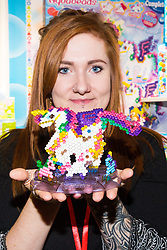The Aquabeads Magical Unicorn Set from Epoch Making Toys retails at £14.99 and allows children to make various characters using beads and a template, which upon being sprayed with water, set to form the characters.  Ahead of Christmas the Dream Toys exhibition at St Mary's Church in Marylebone, London showcases the hottest toys in the market including the top twelve. London, November 14 2018.
