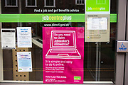 Front window of the Blandford Forum job centre plus in England, United Kingdom.  Jobcentre Plus is a brand used by the British Government's Department for Work and Pensions for its working-age support service.  It helps unemployed people apply for social security benefit (jobs seekers allowance) and assists them to gain employment.  Jobcentre's have experienced a significant increase in demand for their services during the financial recession and government changes to the welfare system.
